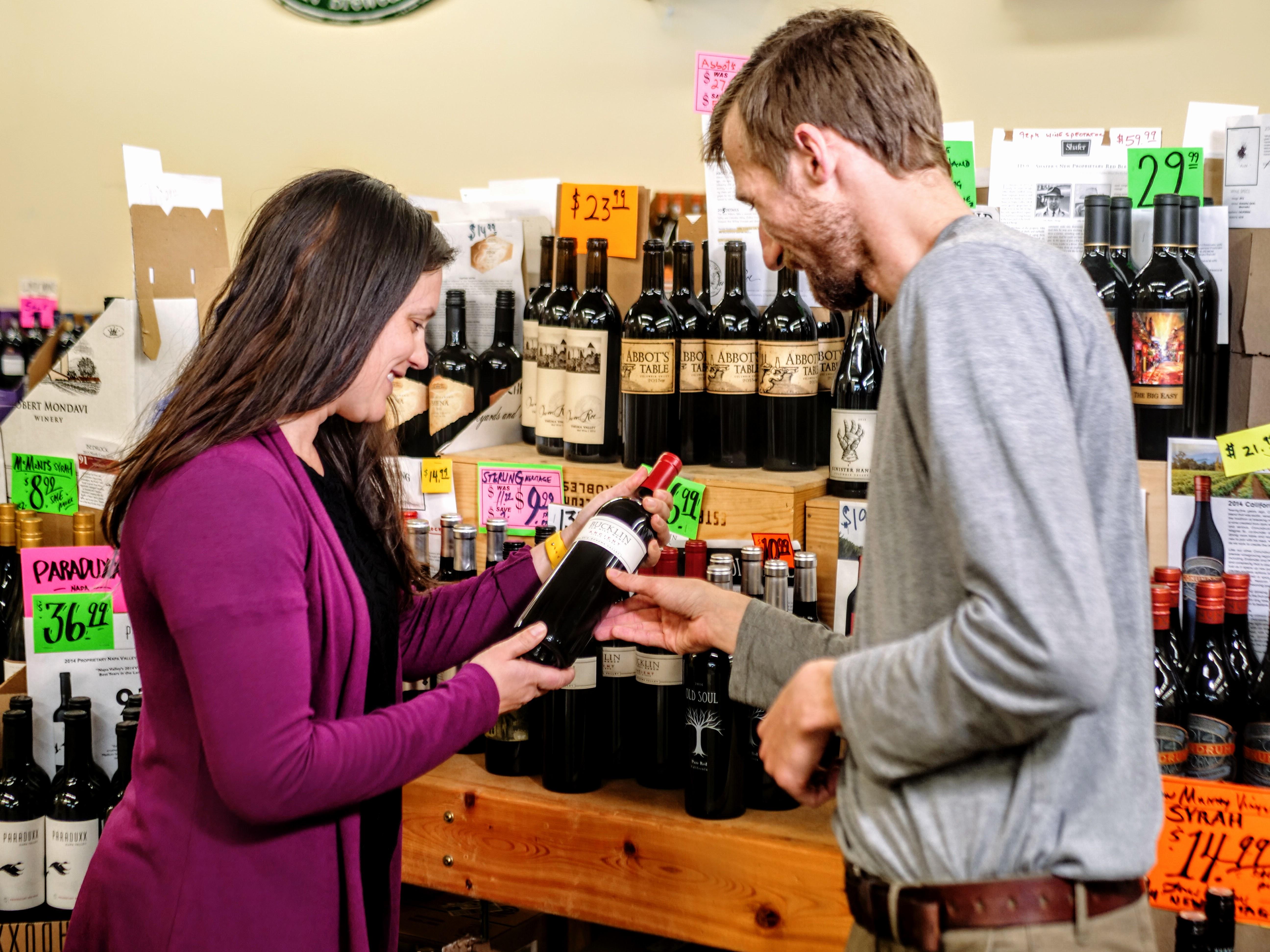 PJ's Associate helping customer find wine